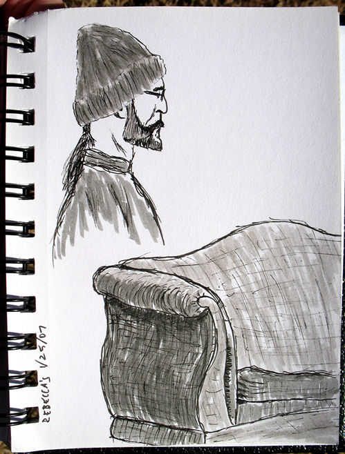 guy in hat, scruffy couch; click for larger version